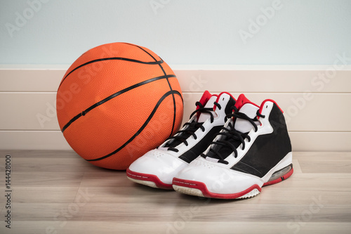 Sport Shoes And A Basketball
