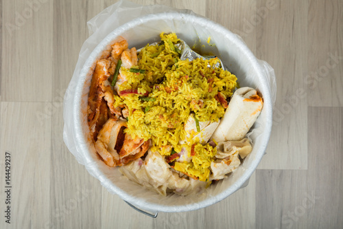 Leftover Food In Trash Bin - 144429237