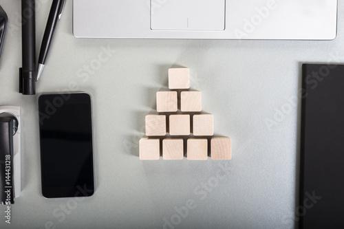 Wooden Block On Desk Poster