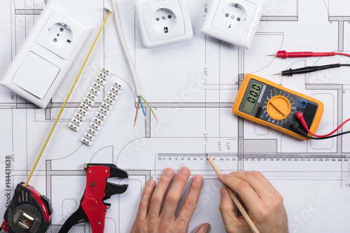 Poster Architect Drawing Plan On Blueprint With Electrical Components