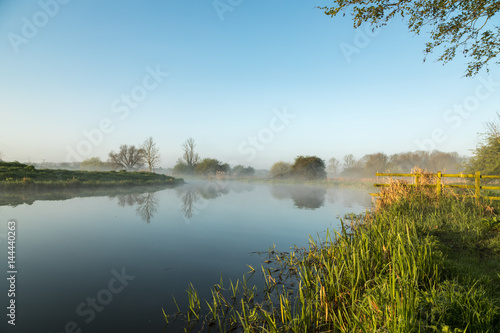 Mist hanging over river Nene in Northamptonshire at sunrise