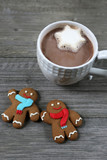 A Cup Of Hot Chocolate With A Gingerbread Men Cookies