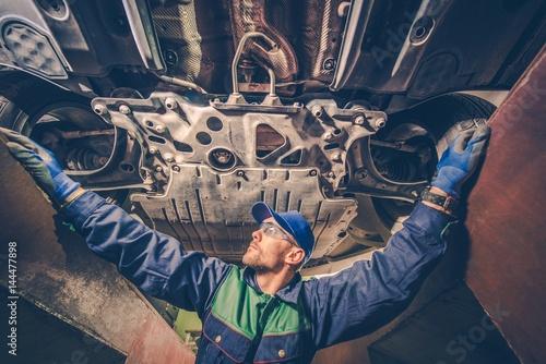 Auto Mechanic Under the Car