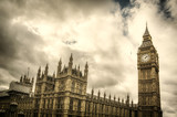 The Big Ben and Houses of Parliament in London, England, UK with dramatic cloudy sky