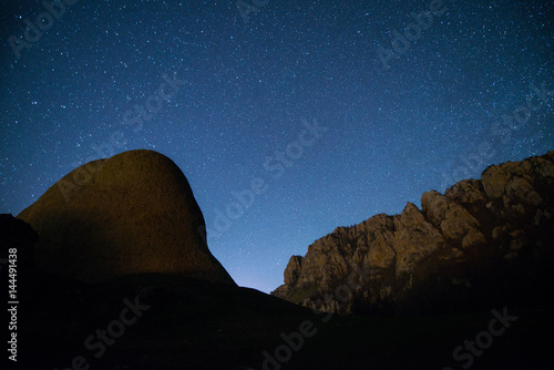 The starry sky above the  mountains peaks