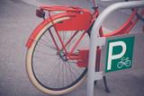 Retro bicycle on bike parking
