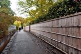 Bamboo fence along walkway in Arashiyama, Kyoto, Japan