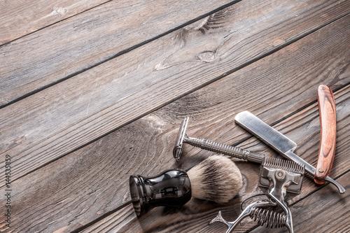 Vintage barber shop tools on wooden background Poster