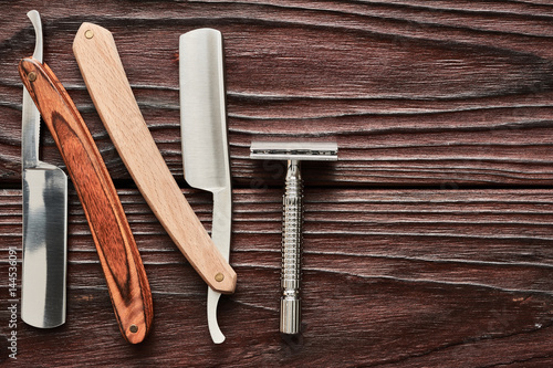 Vintage barber shop razor tools on wooden background Poster