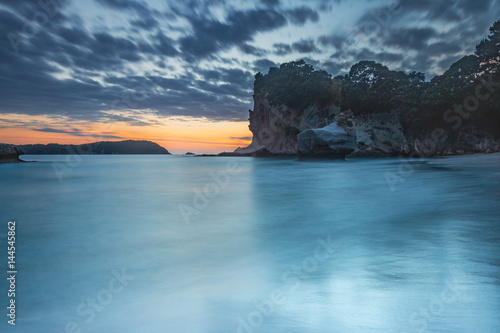 Long exposure of sunrise at Cathedral Cove, Coromandel, New Zealand