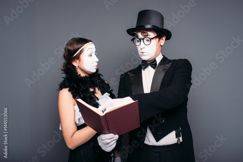 Two pantomime theater performers posing with book Poster
