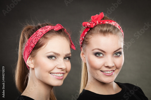 Portrait of retro pin up girls in red handkerchief.