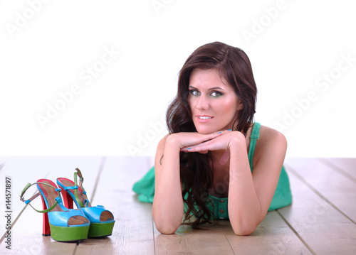 Plakat Beautiful young woman in dress lying on the floor
