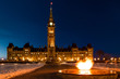 Parliament of Canada in Ottawa and Centennial Flame Winter