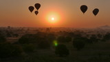 Hot air balloons over temple landscape at dawn in bagan, myanmar