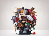 Big heap of different clothes and shoes - 144585490