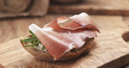 sandwich with italian speck, arugula and cream cheese, 4k photo