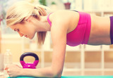 Fit healthy young woman doing a plank
