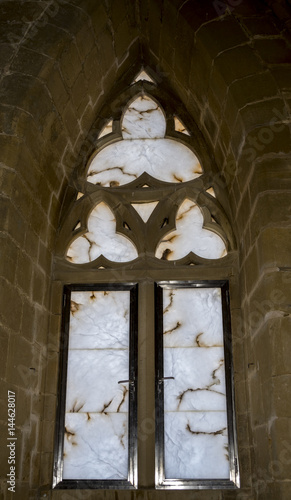 Windows of the lookout tower of the Uncastillo Castle. It is a historic town and municipality in the province of Zaragoza, Aragon, eastern Spain. In 1966 it was declared a Historic-Artistic site