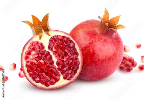 Pomegranate isolated. Whole pomegranate and its half isolated on white background