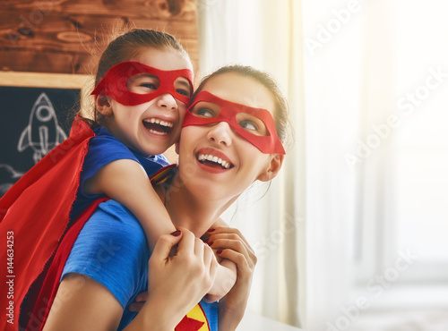 Girl and mom in Superhero costume - 144634253