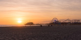 Fototapety Santa Monica Pier sunset with cloud and orange sky, Los Angeles, USA