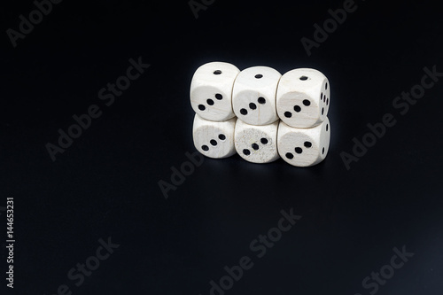 Plakat Dice six triples on a black background