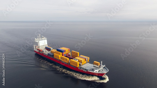 Aerial view of container vessel sailing in the sea