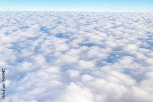 Blue sky and Cloud Top view from airplane window,Nature background