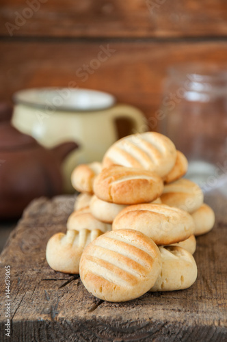 Poster Close up of  heap of freshly baked rice flour ginger cookies on a wooden background