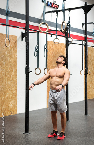 Athlete psyching himself up to workout on rings