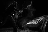 masked man smashing guitar