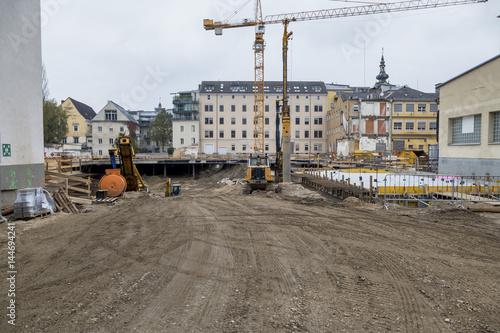 Leinwanddruck Bild Neubauten in der Stadt