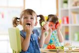 Fototapety children eating vegetables in kindergarten or at home