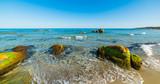 Sand and rocks in Musculedda beach
