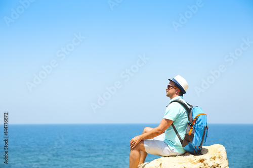 Man on rock above the sea