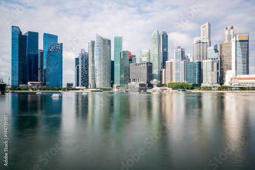 Singapore business district with skyscraper building and reflection at Marina Bay, Singapore Poster