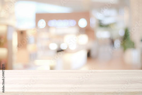Empty wooden table over blur store background, product and food display montage background - 144721281