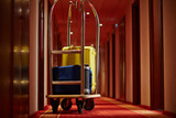 Cart of porter with suitcases in aisle of hotel - 144721848