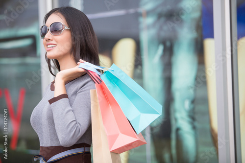 happiness, consumerism, sale and people concept - smiling young Asia woman with Poster