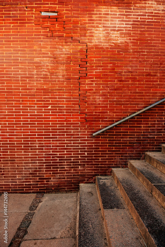 Old weathered staircase and brick wall