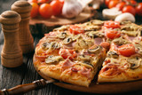 Homemade pizza with ham,mushrooms, tomatoes and cheese. - 144742219