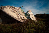 rotting wooden boat