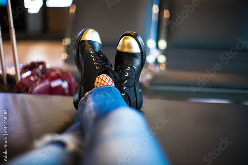 woman waiting boarding on aircraft in airport lounge