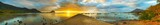 Sunset over sea. Le Morn Brabant on background. Panorama