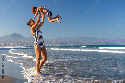 A Mother and her son is having fun at seashore of Mediterranean sea