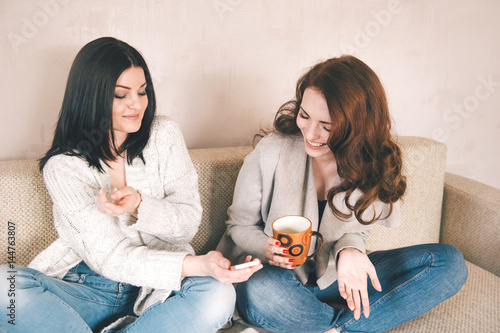 Two female friends having fun together at home Poster