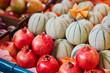 Fresh organic melons and pomegranates on farmers market