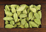 green cardamom in wooden box isolated - 144768078