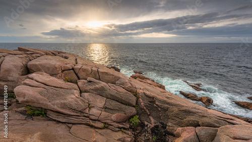 Ocean sunrise with rocky cliffs, Cape Breton Island